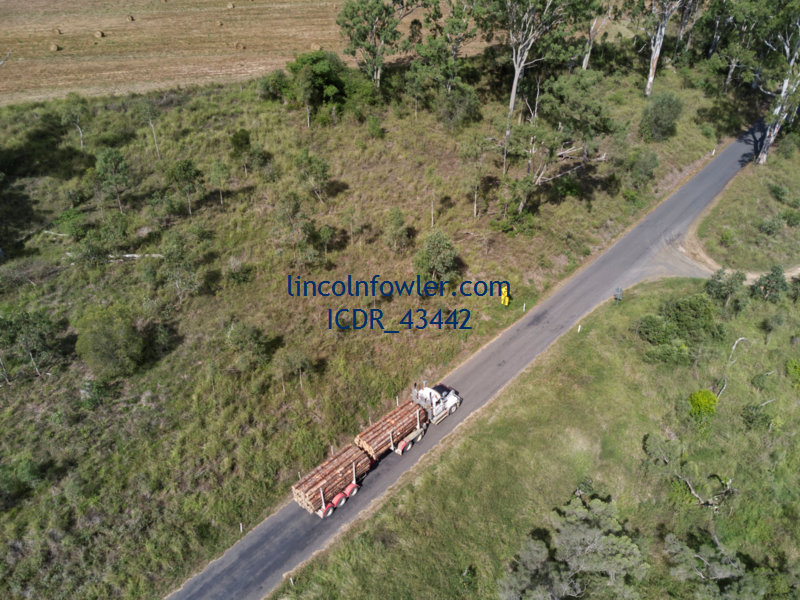 Logging truck crossing causeway Booyal Crossing Queensland Australia