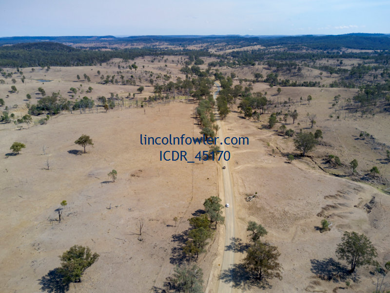 Country road passing drought affected landcape Queensland Australia